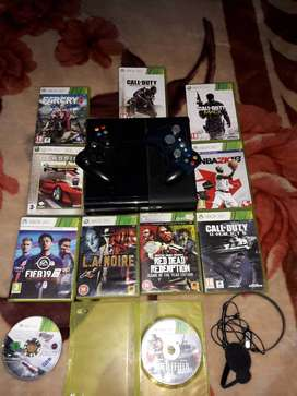Xbox 360 for sale ,2 controllers and 11 games