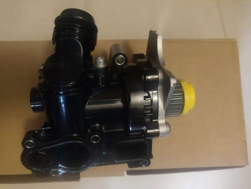 Vw & Audi new complete water pumps with thermostat housing 0