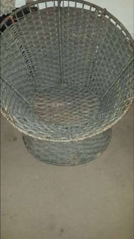 Metal framed wicker style indoor or outdoor relaxing sink in chair