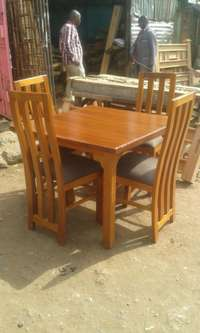 Four seater hard wood dining table 0