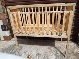 Wooden Cot on wheels