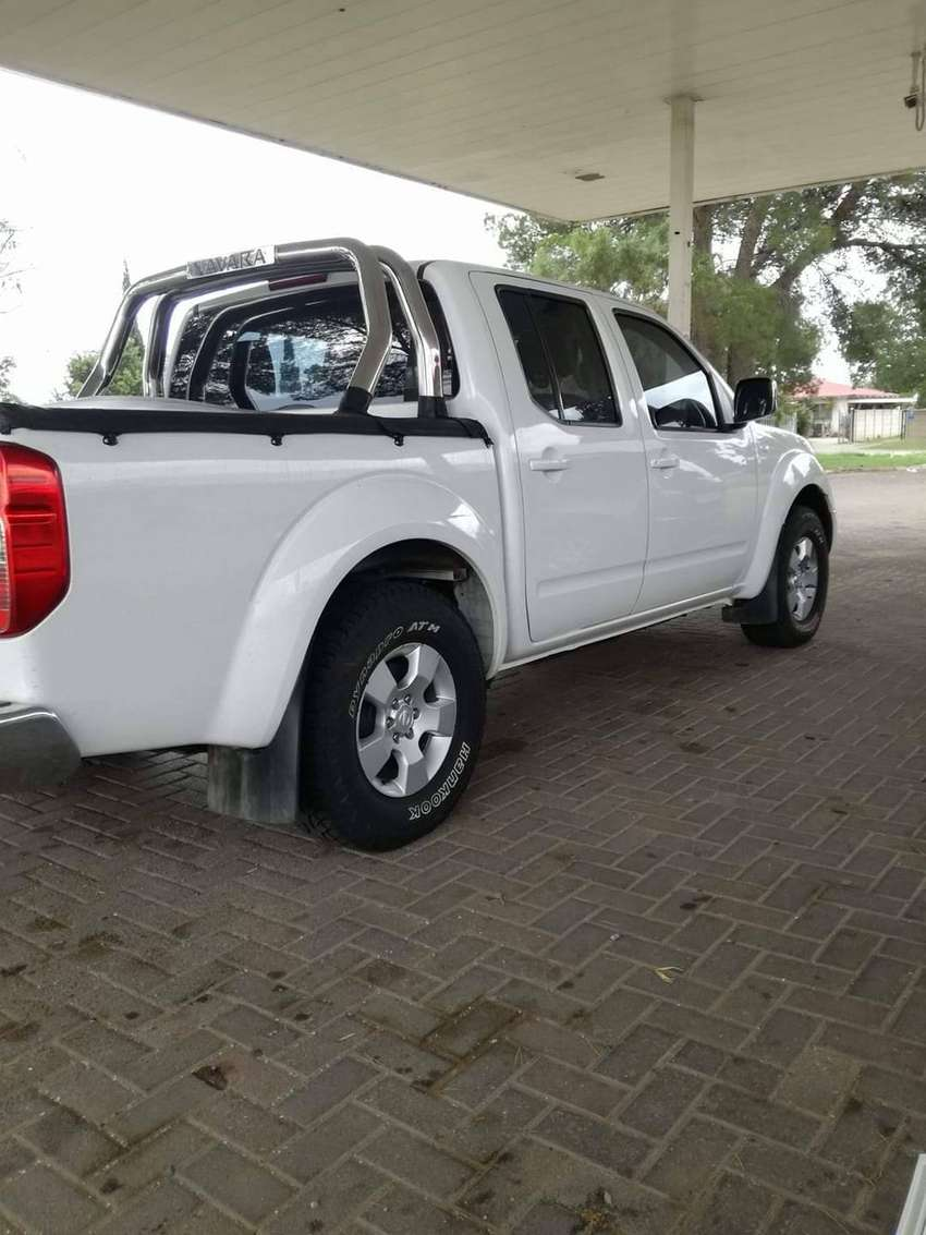 It is a nissan navara 2014,it has 4 years six month 0