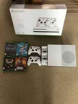 Microsoft Xbox one S, 2 remotes and 4 games.