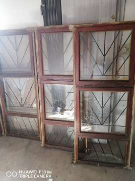 wooden windows with burglers