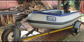 4 M Rubber duck with 20 HP Mercury engine.