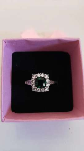 Emerald green gemstone 18ct white gold wedding ring for sale