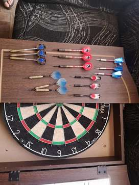 Dart board and cabinet with darts