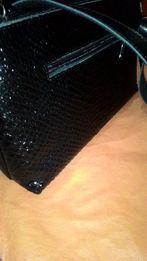 Новая кожаная сумочка.