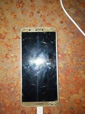 Hauwei P Smart, it is rather old and its screen is badly cracked...