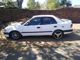 White Corolla wit mags as it appears ...price negotiable