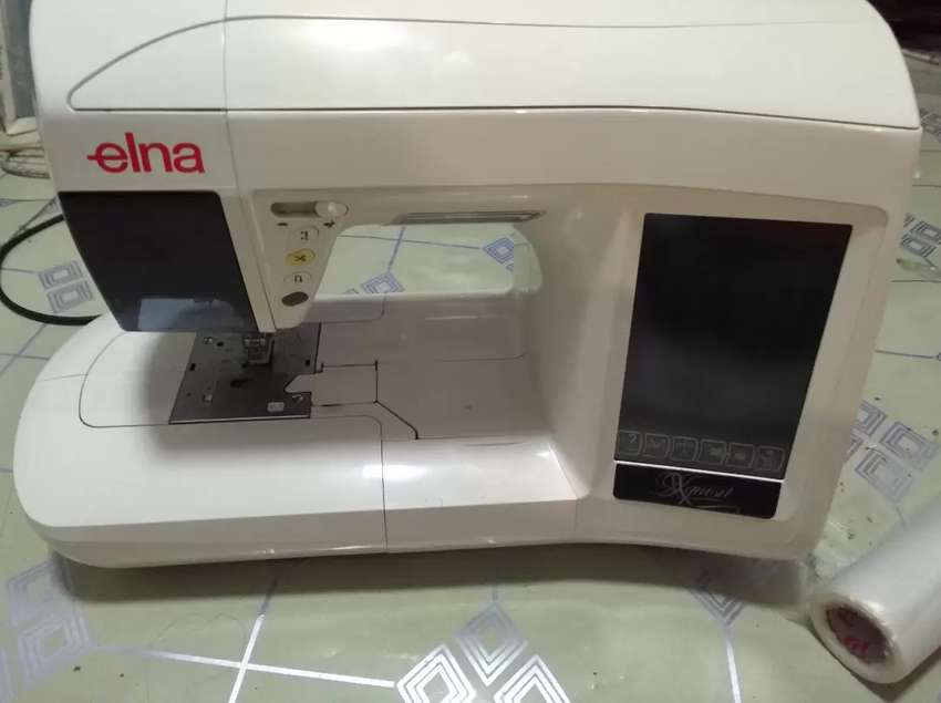 embroidery machine , it's a two in one machine  Good working order 0