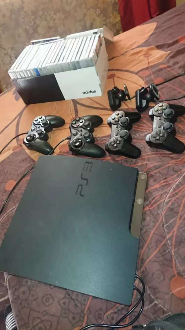 Playstation 3 with 32games with 4 controls and 2 cameras 0