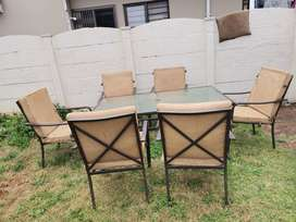 Patio table with 6 cushion chairs
