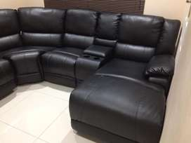 Corner lounge suite with recliner and chaise