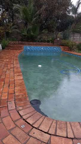 SWIMMING POOLS AND PAVING