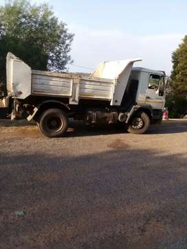 Tipper trucks and rubble loading