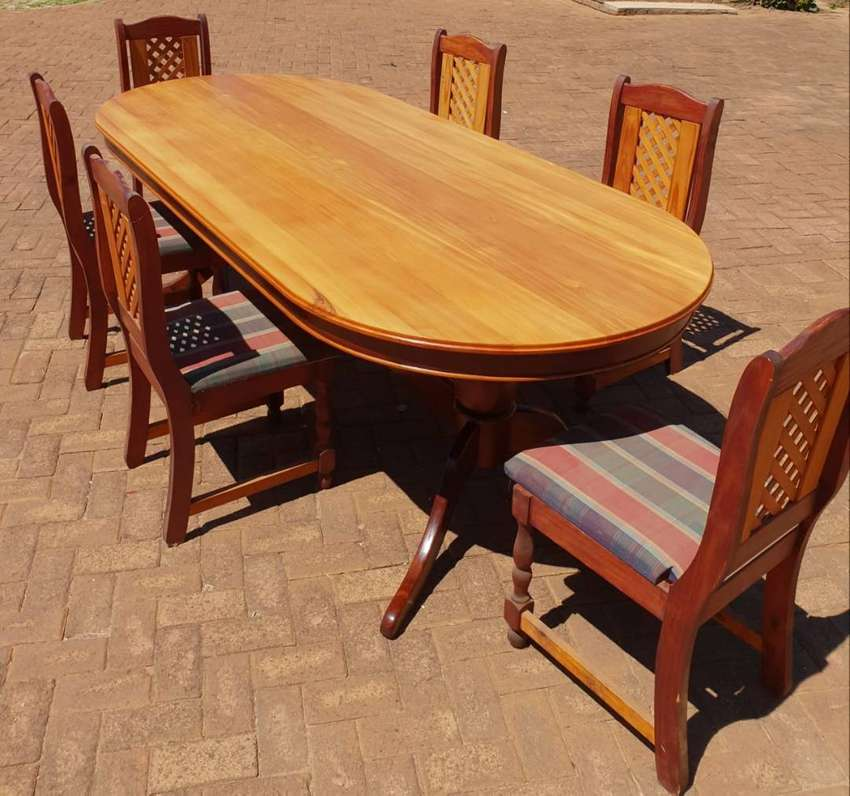 8 seater Yellow wood dining room table with chairs 0