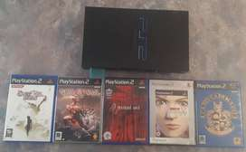 Playstation 2 console & 5 games for sale.