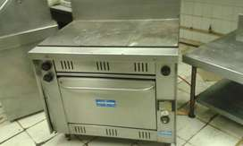 Flat top gas griller with gas oven.