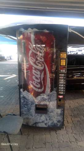 Coin operated softdrink vending machine