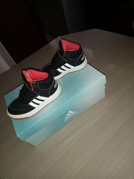 Adidas Black,white and Orange kids shoes