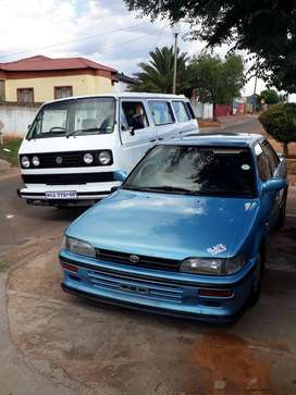 Two cars microbus 2.1 automatic and Toyota Corolla 1.8 gle