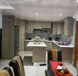 Fitted kitchen cupboards.