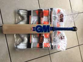 Brand new and unused GM cricket bat (size 2) and junior cricket pads.