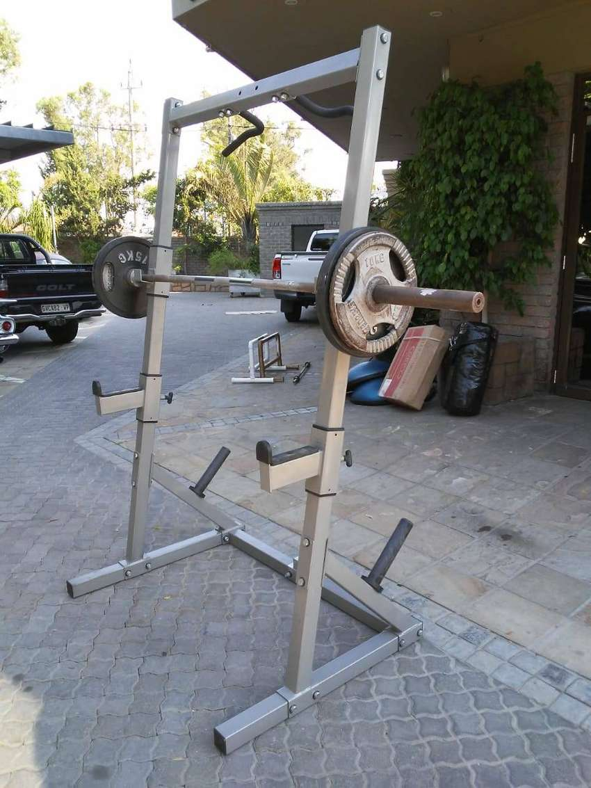 Squat Rack and/or weight plates for sale 0