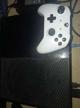 Xbox one with a controllers and games