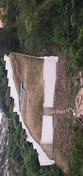 Land for sale with built foundation and perimeter walls