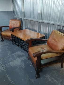 Pair of antique leather seats chairs and wrought iron coffee table