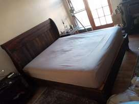 Wooden bed with mattress