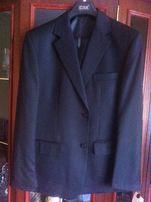 Nowy elegancki czarny garnitur 182/112