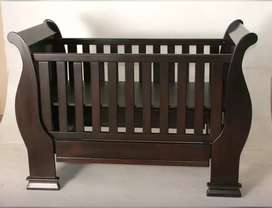 Solid wood sleigh cot for sale.