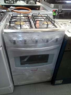 4 plates gas stoves with oven in a white colour