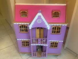 Wooden doll house with furniture and dolls