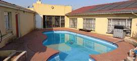 House and 6 Flats for sale