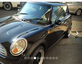 2010 Mini Cooper, Black , petrol, manual and low kilometres.