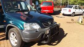 2.0 Honda CR.V on the road with papers car is very clean