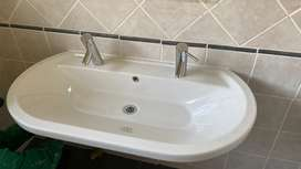 Bathroom basin with two mixers
