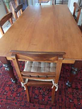 Yellow and stinkwood table and 8blackwood chairs