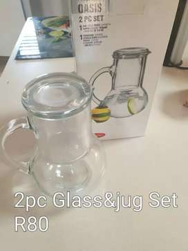 Glass jug and cup and a honey dispenser