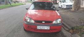 Ford ikon, 2005 model  manual red in color