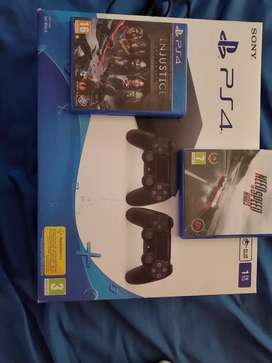 Ps4 1tb with 2 controllers and 2 games