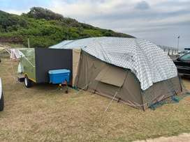Camp trailer and tent