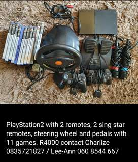 PlayStation 2 console with controls and games.