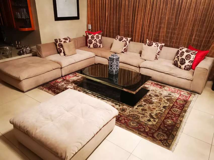 Imported elegant over sized L/U shaped couch in exceptional condition