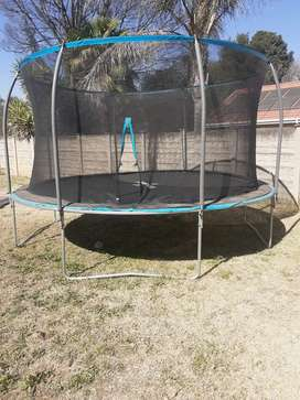 Bouncing Trampoline 14 FT with safety net bearly used( excellent