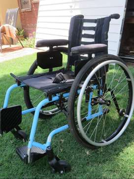 Pacer Lite Folding Wheelchair for a 10 to 14 year old or small adult.